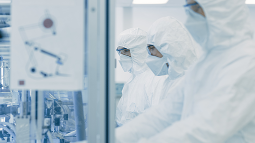 01 - Team of Scientists in Sterile Protective Clothing Work