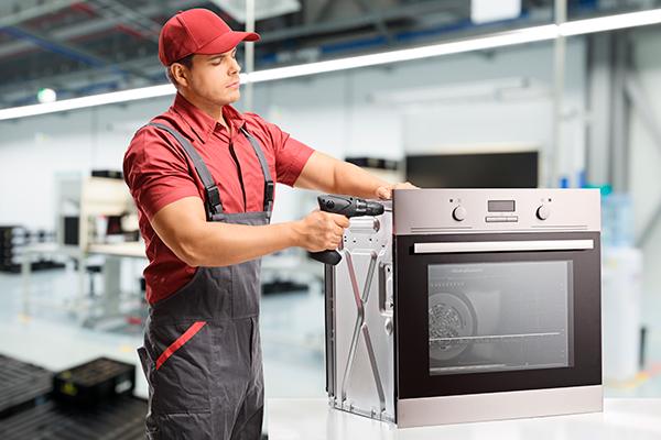 man-in-red-ensambling-oven
