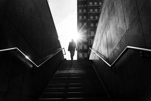 man-walking-on-stairs
